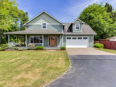 Photo for Modern home w/ private hot tub & wraparound deck - just blocks from beach