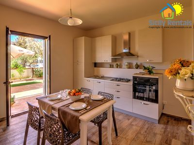 Photo for Beautiful apartment with big outdoor space few steps from the beach