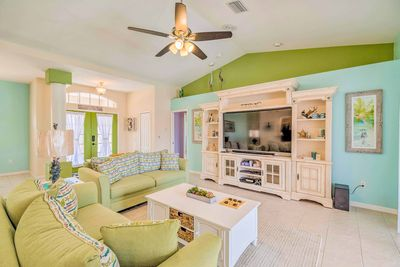 Charming coastal decor highlights the bright and open living space.