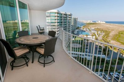 Spacious patio with views of pool, marina and Gulf