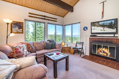 Living Room - Welcome to Tahoe! The grand living room features vaulted wood ceilings, large windows, and a fireplace.