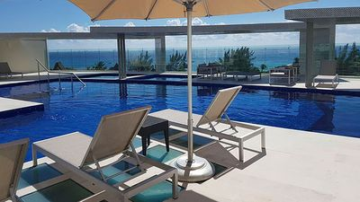 Photo for Luxury Condo Ocean view 1 Pool 2 Jacuzzi 1 minute from Beach & 5th Avenue