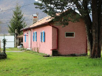 Photo for Pretty pink house with blue shutters