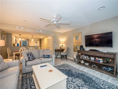 Living in Comfort - Experience the crystal-clear flat screen in the living room at Greens 194. There are comfortable, clean sofas with enough space for everyone to relax after a long day in the South Carolina sun.