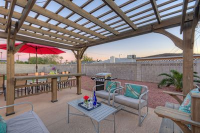 This backyard oasis with charming gazebo includes a pool with option to heat, gas grill, TV and outdoor fridge
