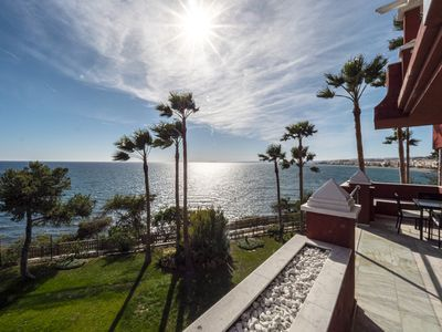 Photo for BEACH front condo, high speed wifi, free parking, smart TV, walk to Estepona
