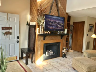 Great room with spacious seating and warming fireplace.