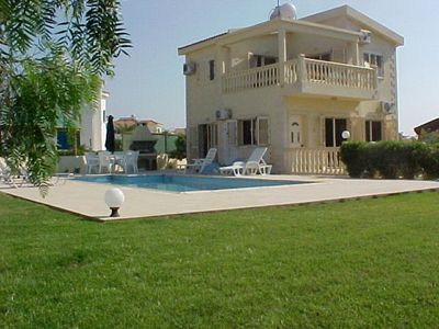 Side view of villa with private pool