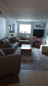 Brand new living room set with queen sleeper sofa, flat screen tv with Direct TV