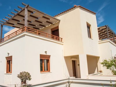 Photo for 3 bedroom house,100m from the beach,Panormo village,Full amenities shared pool