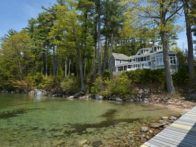 Photo for Gracious lakefront estate with 5 bedrooms, set on 12 acres with sandy beach and sunsets.
