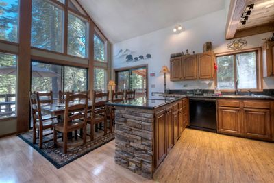 Dining room table with 12 chairs. Large kitchen with granite countertops