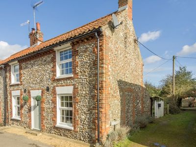 Photo for A pretty, traditional brick and flint cottage with an attractive & secure garden