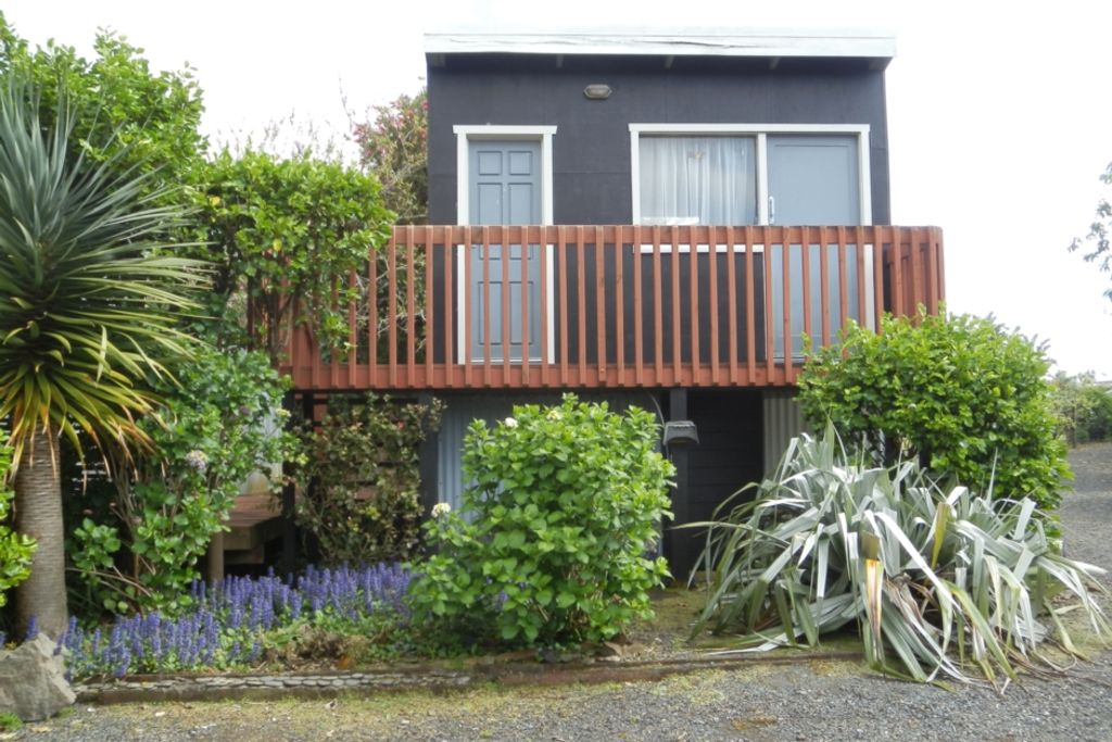 Modern 2 bed bach in a very private garden setting