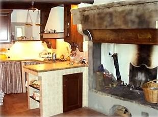 Kitchen - Cooking Area next to a 15th-century Fireplace