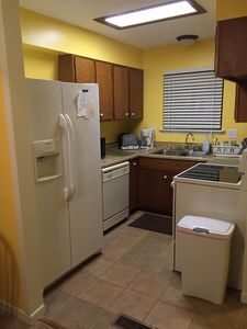 Bright kitchen with brand new stove and  fridge that makes lots of ice!