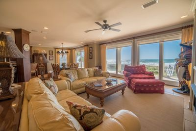 Living room with leather sofas and gorgeous views!