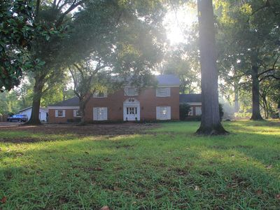 Photo for Historic home on 2+ wooded acres w/ pool in heart of Nacogdoches
