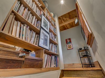Entrance to the studio.Book lined staircase.