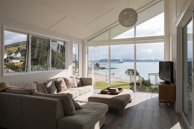 Living room with sea views. A comfy corner sofa faces both the sea and the TV