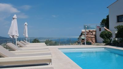 Photo for Modern villa with splendid sea & mountain views, heated pool, air conditioning