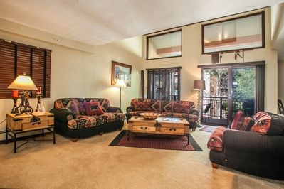 Spacious living room has comfortable seating for 6. Gather with friends and family. Sliding door opens to deck with grill and outdoor seating.