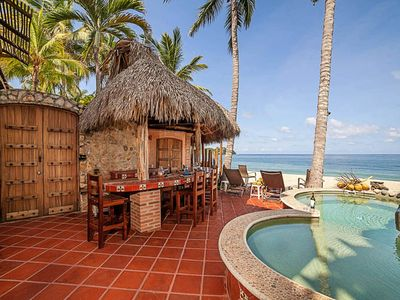 Photo for Rooftop patio, open air showers, palapa bar and dipping pool on the beach!