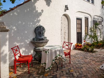 Photo for Near Beach and Downtown! Award-winning historic carriage house and garden
