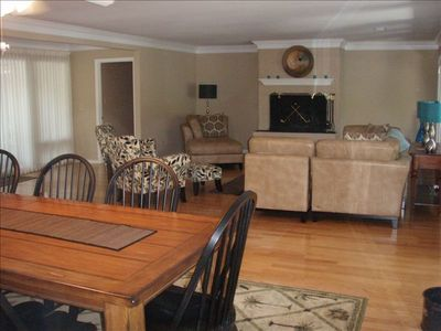 Great room with open dining room and french doors to back yard
