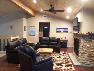 Open Family Room with 50' TV, in-ceiling speakers and new leather couches
