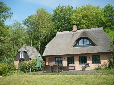 Photo for Romantic thatched cottage by the lake, south-facing terrace and south-facing garden, child-friendly