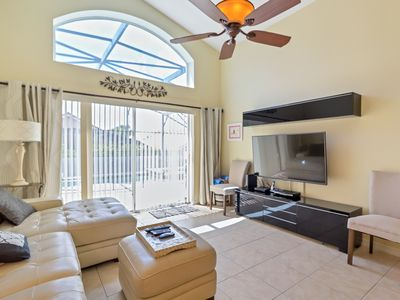 Photo for CONTEMPORARY 5 BEDROOM POOL HOME. CLOSE TO DISNEY, SEA WORLD AND ALL ATTRACTIONS