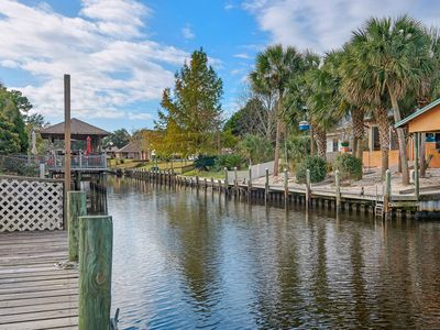 Photo for Spacious, dog-friendly home with a private pool & jet ski lift, on the canal!