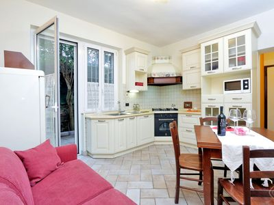 Photo for A homely and warm two-bedroom apartment with garden for up to five people a short stroll from the hi