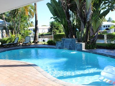 Photo for Backyard Paradise: 2bd/2bath Waterfront Home With Pool, Tiki Bar