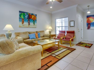 Inviting condo w/ private patio, updated amenities, & shared pool!