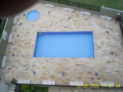 Photo for Apartment on the beach, walk in the sand in Itanhaem, with pool and sea view