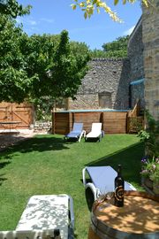 Holidays in Lagrasse. Stunning medieval apartment set in walled garden with pool