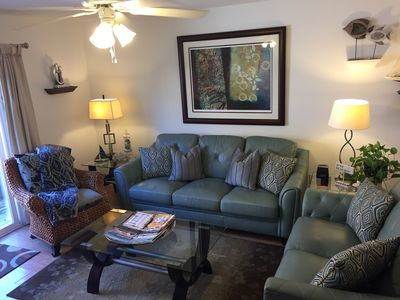 Comfy living area with upscale leather furniture and modern design.