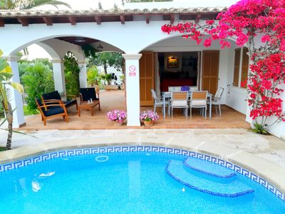 Photo for Fantastic 3 bedroom villa with pool, 1minute walk from beach in Cala D'Or.