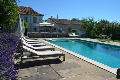 Private, fenced diving pool with sun loungers, umbrellas and space to rest.