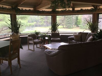 Relax in the large screened-in octagon porch