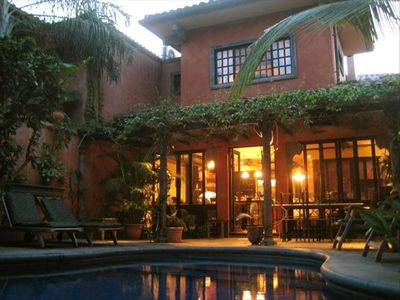 Private pool behind the house, in a walled courtyard.