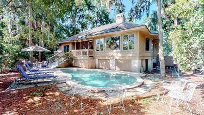 Photo for Screened in porch, private pool, gas grill, short walk to the beach