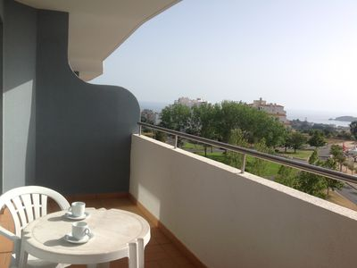 Photo for Cozy apartment with sea view and walking distance to Praia da Rocha