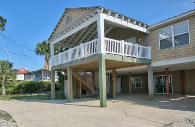 Photo for 6 Bedroom Beach House with POOL!! Gulf Front with 300' Dock on Bay