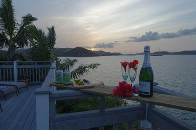 Late afternoon bubbly by theprivate  pool with islands in back ground.