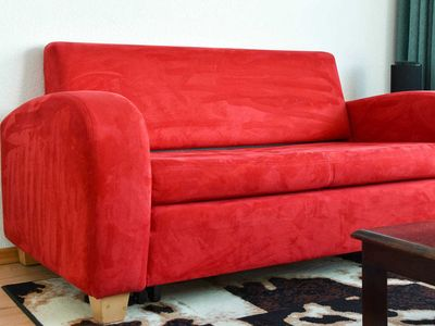 Photo for Vacation Apartment Red Sofa - Red Sofa
