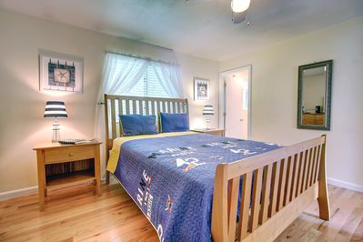 Master bedroom with private bath and queen bed with flat screen TV.