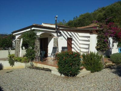 Photo for Villa in a quiet setting, 5 minutes from the sea, 50 meters from a nuraghe.